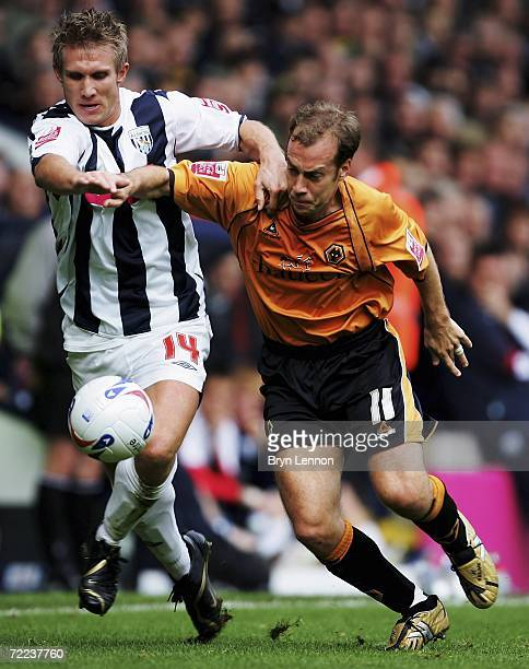 Martin Albrechtsen of West Bromwich Albion holds off Jamie Clapham of Wolverhampton Wanderers during the during the CocaCola Championship match...