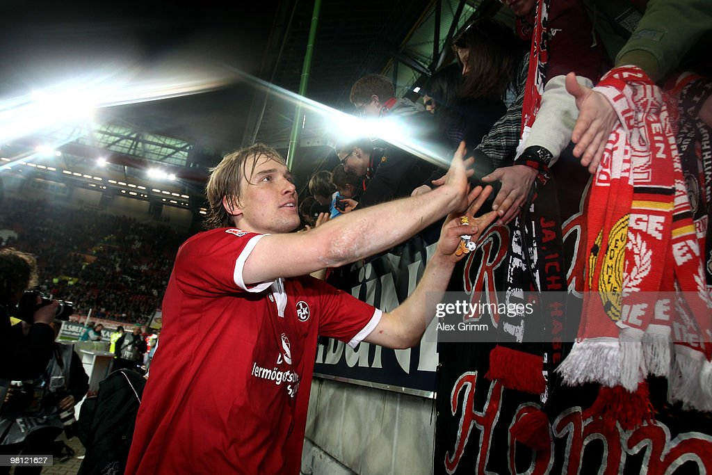 Martin Amedick of Kaiserslautern celebrates with supporters after the Second Bundesliga match between 1. FC Kaiserslautern and 1860 Muenchen at the Fritz-Walter Stadium on March 29, 2010 in Kaiserslautern, Germany.