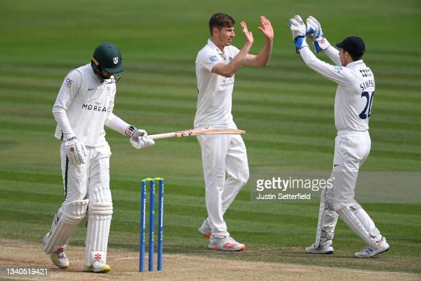 Martin Andersson of Middlesex celebrates with John Simpson of Middlesex after taking the wicket of Ed Barnard of Worcestershire during the LV=...