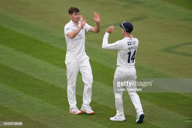 Martin Andersson of Middlesex celebrates with Robbie White of Middlesex after taking the wicket of Charlie Morris of Worcestershire during the LV=...