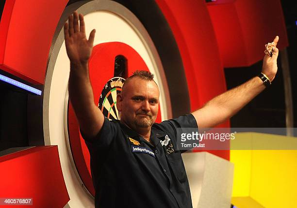Martin Atkins of England celebrates his win on day one of the BDO Lakeside World Professional Darts Championships at Lakeside Complex on January 4...