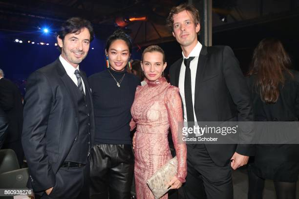 Martin Bachmann and his wife Huong Vu, Nadeshda Brennicke and Florian Stelljes during the 'Tribute To Bambi' gala at Station on October 5, 2017 in...