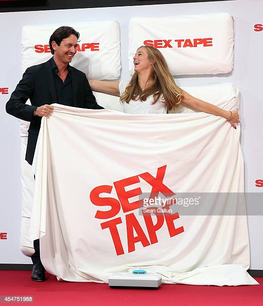 Martin Bachmann and Nina Eichinger arrive for the German premiere of the film 'Sex Tape' at CineStar on September 5 2014 in Berlin Germany