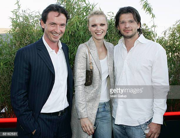 Martin Bachmann German model Franziska Knuppe and her husband Christian Moestl attend the Bild Summer Party at the Axel Springer publishing house...