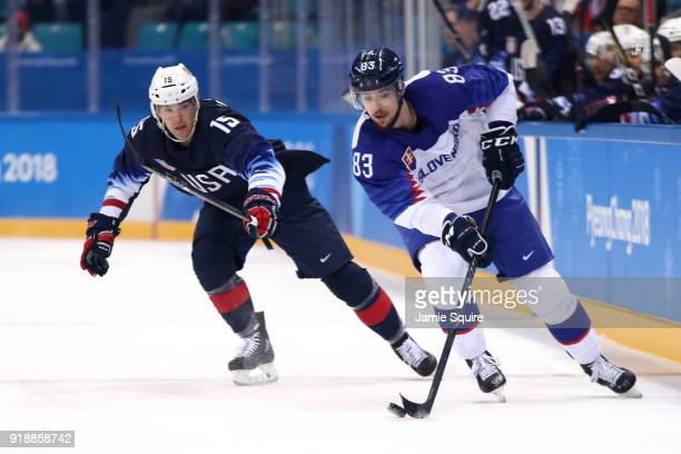 Martin Bakos of Slovakia handles the puck against Bobby Butler of the United States during the Men's Ice Hockey Preliminary Round Group B game at...