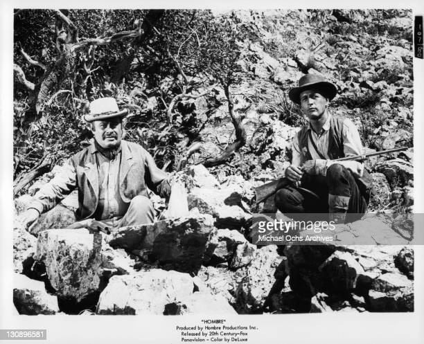 Martin Balsam And Paul Newman with guns in a scene from the film 'Hombre' 1967