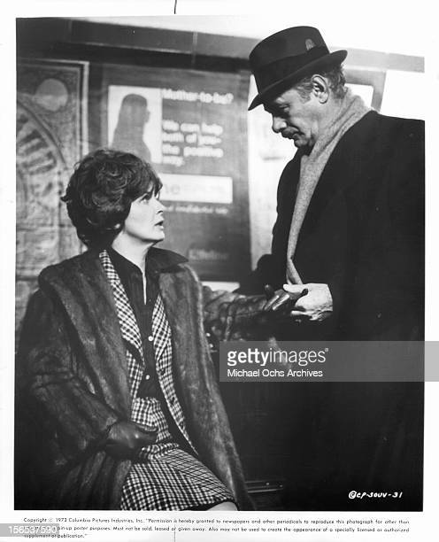 Martin Balsam rushes to the subway station to help Joanne Woodward in a scene from the film 'Summer Wishes Winter Dreams' 1973