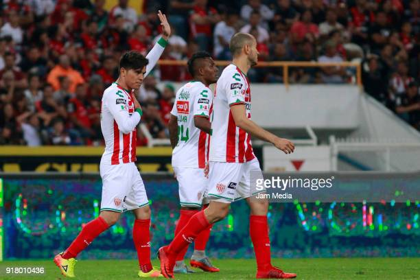 Martin Barragan of Necaxa celebrates with teammates after scoring the first goal of his team during the 7th round match between Atlas and Necaxa as...