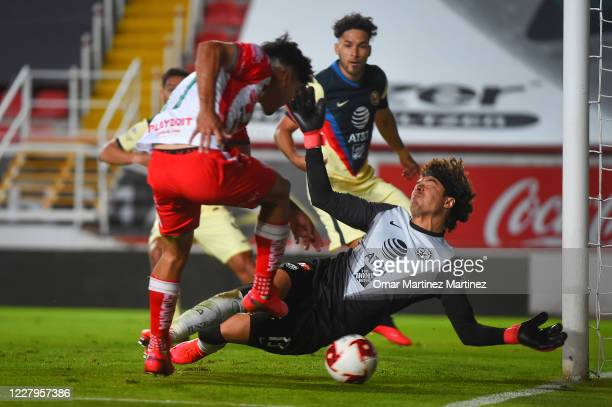 Martin Barragan of Necaxa fights for the ball with Guillermo Ochoa of America during the 3rd round match between Necaxa and America as part of the...