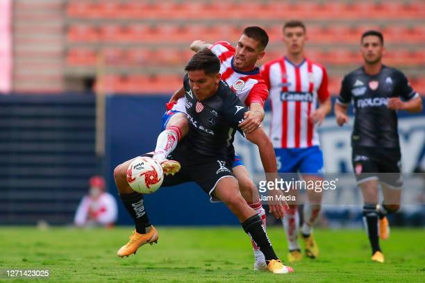 Martin Barragán of Necaxa fights for the ball with Ventura Alvarado of San Luis during the 9th round match between Atletico San Luis and Necaxa as...