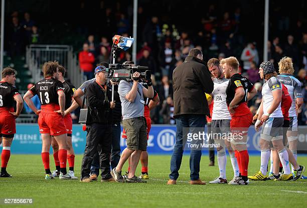 Martin Bayfield of BT Sport with TV cameras interviews Jackson Wray of Saracens after the Aviva Premiership match between Saracens and Newcastle...