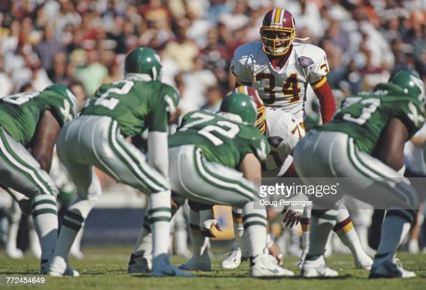 Martin Bayless Strong Safety for the Washington Redskins stares down Quarterback Randall Cunningham and the Philadelphia Eagles offensive line during...
