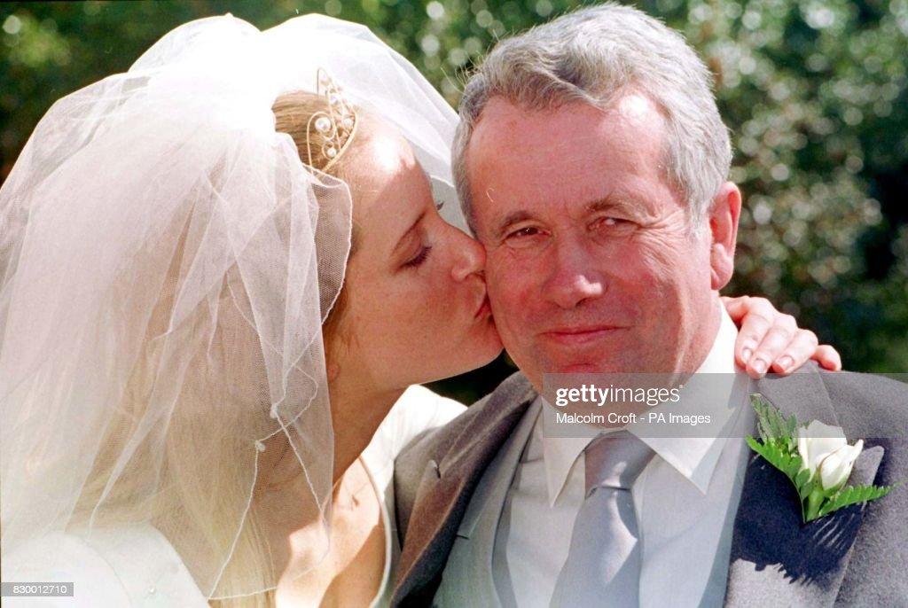 MP Martin Bell receives a kiss...