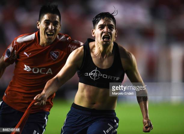Martin Benitez of Independiente celebrates with teammate Leandro Fernandez after scoring the second goal of his team during a second leg match...
