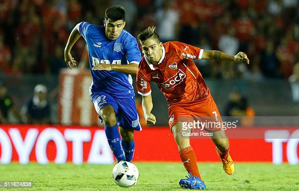 Martin Benitez of Independiente fights for the ball with Marcos Acuña of Racing Club during the 4th round match between Independiente and Racing Club...