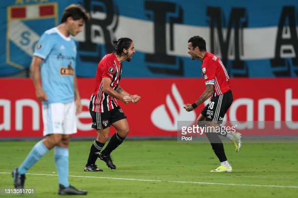 Martin Benitez of Sao Paulo celebrates with Dani Alves after scoring the second goal of his team during a match between Sporting Cristal and Sao...