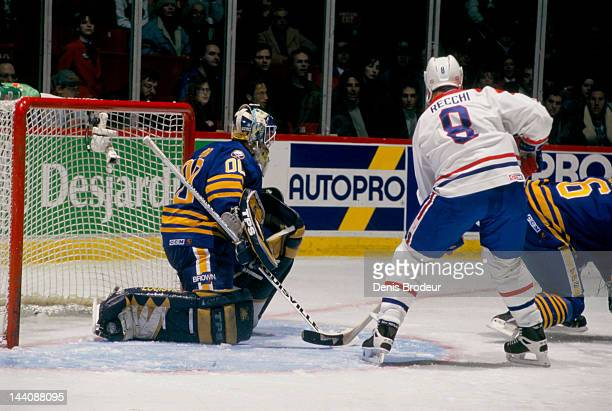 Martin Biron of the Buffalo Sabres watches Mark Recchi of the Montreal Canadiens as he stands near the net Circa 1999 at the Bell Centre in Montreal...
