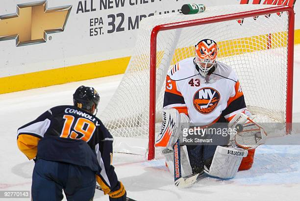 Martin Biron of the New York Islanders makes a save on a shot by Tim Connolly the Buffalo Sabres at HSBC Arena on November 4 2009 in Buffalo New York