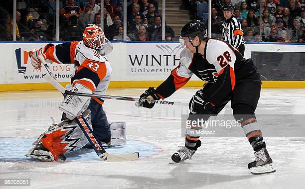 Martin Biron of the New York Islanders makes a third period save against Claude Giroux of the Philadelphia Flyers on April 1, 2010 at Nassau Coliseum...
