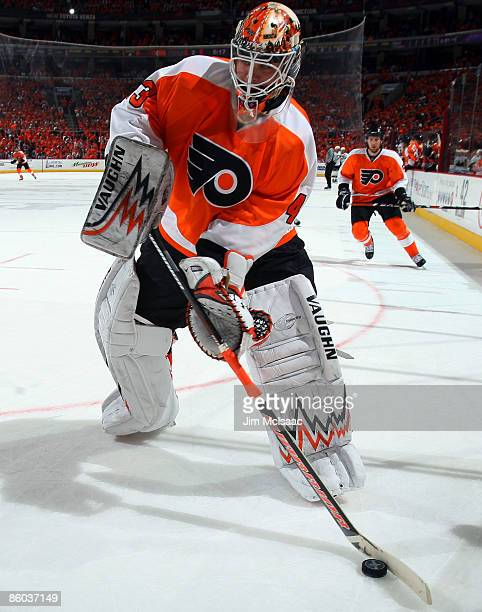 Martin Biron of the Philadelphia Flyers controls the puck against the Pittsburgh Penguins during Game Three of the Eastern Conference Quarterfinal...