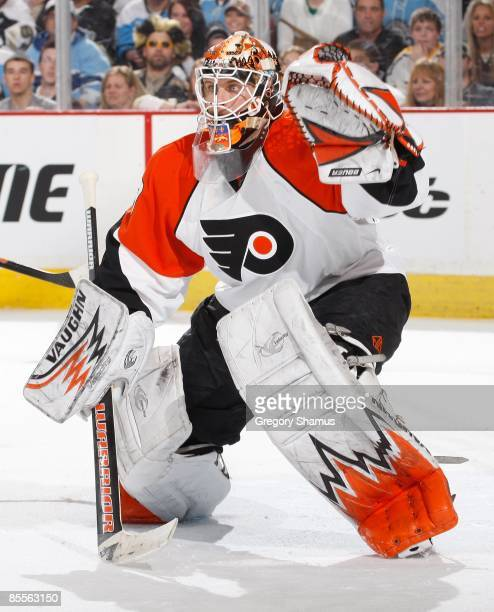 Martin Biron of the Philadelphia Flyers looks up ice against the Pittsburgh Penguins on March 22 2009 at Mellon Arena in Pittsburgh Pennsylvania