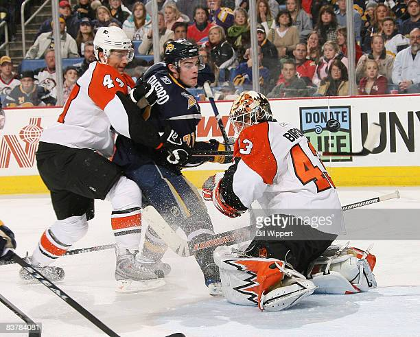 Martin Biron of the Philadelphia Flyers makes a save against Drew Stafford of the Buffalo Sabres with help from Luca Sbisa on November 21, 2008 at...