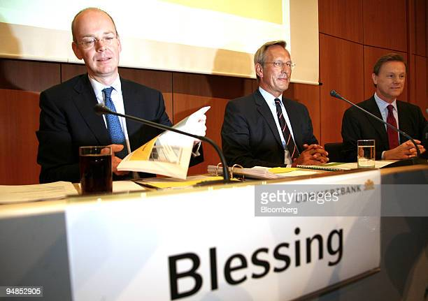 Martin Blessing chief executive officer of Commerzbank left sits with Michael Diekmann chief executive officer of Allianz center and Herbert Walter...