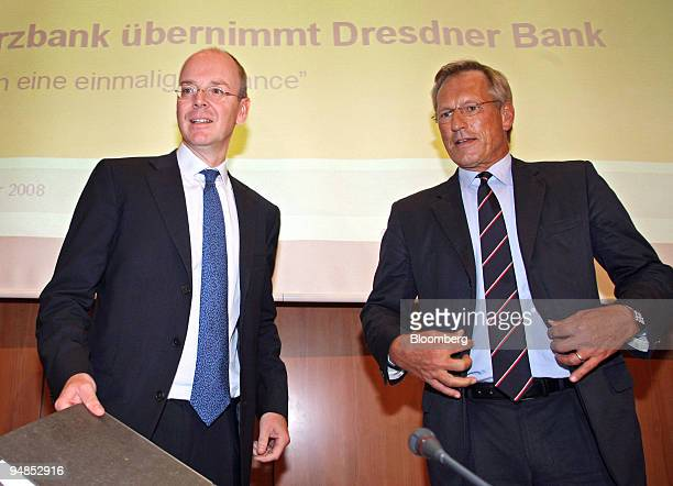 Martin Blessing chief executive officer of Commerzbank left stands with Michael Diekmann chief executive officer of Allianz prior to the start of a...