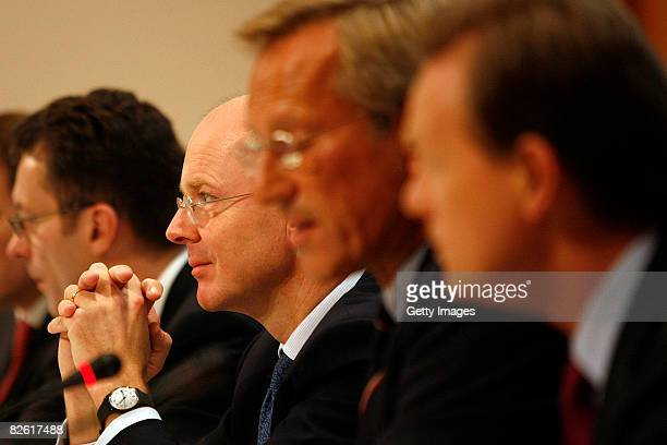 Martin Blessing Michael Diekmann CEO Allianz AG and Herbert Walter are talking at the press conference for the Dresdner bank sale on September 01...