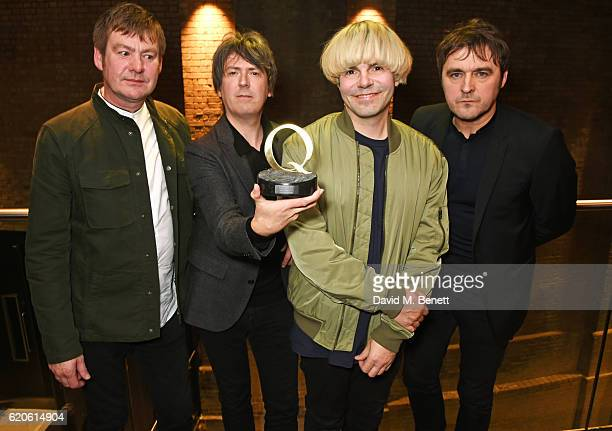 Martin Blunt Mark Collins Tim Burgess and Tony Rogers of The Charlatans winners of the Q Classic Album award for Tellin' Stories pose at The Stubhub...