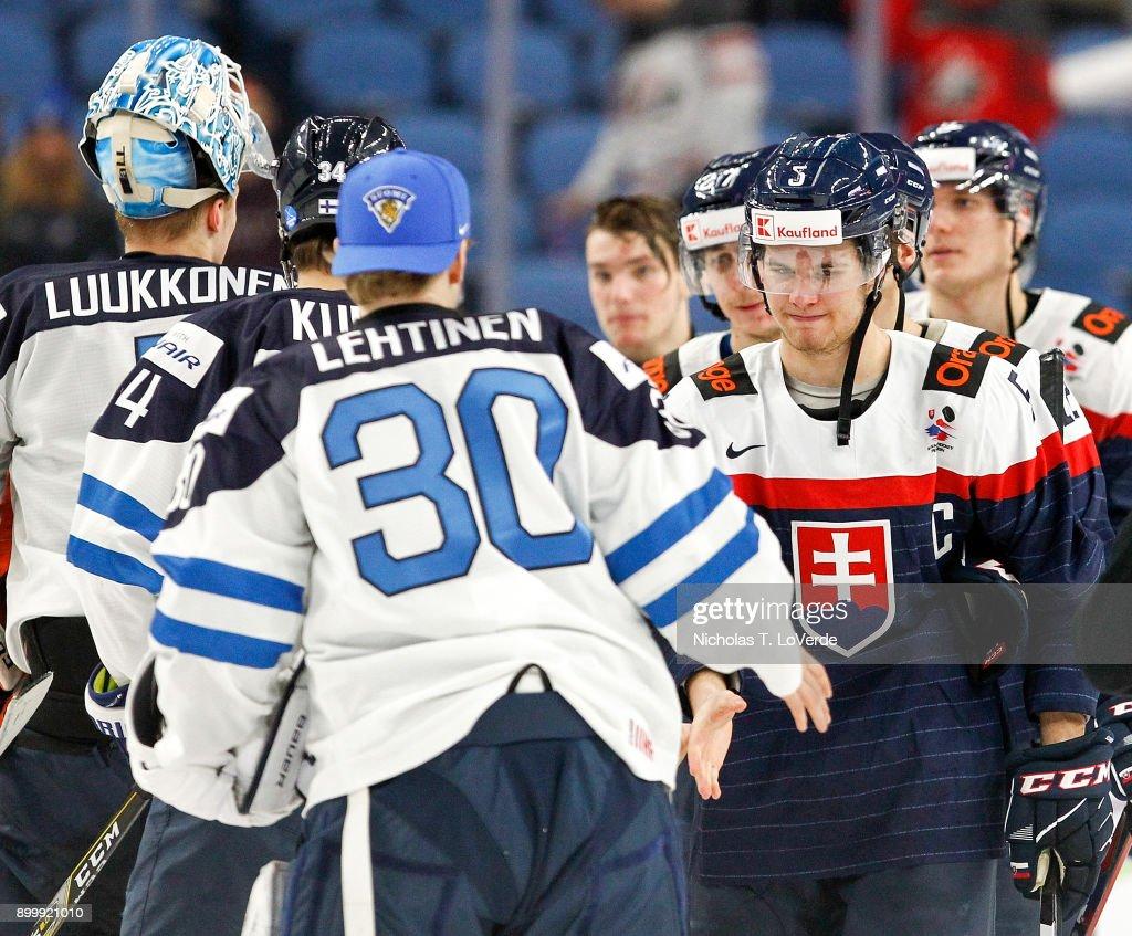 Martin Bodák #5 of Slovakia shakes hands with Lassi Lehtinen #30 of Finland following the third period of play in the IIHF World Junior Championships at the KeyBank Center on December 30, 2017 in Buffalo, New York. Finland defeated Slovakia 5-2.