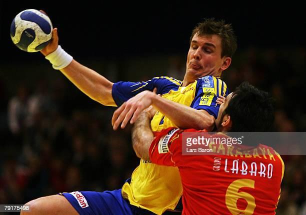 Martin Boquist of Sweden in action with Ruben Garabaya of Spain during the Men's Handball European Championship main round Group II match between...