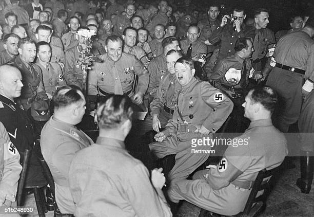 Martin Bormann Hitler's deputy is shown in a 1938 beer cellar scene with Adolph Hitler and Rudolf Hess