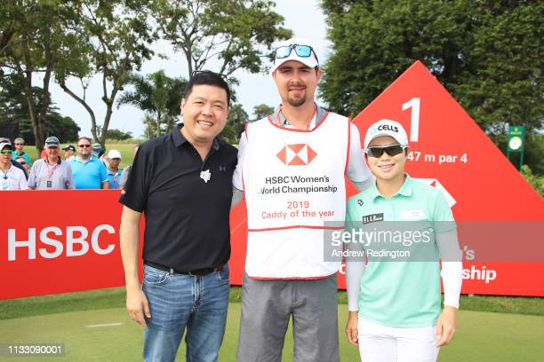 Martin Bozek caddie for EunHee Ji of South Korea is presented with his 2019 Caddy of the Year bib by Eugene Kwek Head of RBWM Marketing HSBC...