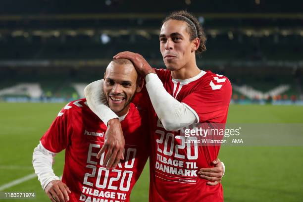 Martin Braithwaite and Yussuf Poulsen of Denmark celebrate at full time after qualifying for Euro 2020 at the UEFA Euro 2020 qualifier between...