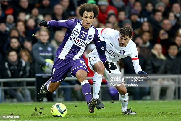 Martin Braithwaite for Toulouse FC and Benjamin Stambouli for Paris Saint Germain battle for the ball during the French Ligue 1 football match...