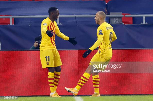 Martin Braithwaite of Barcelona celebrates after scoring their sides second goal with team mate Ousmane Dembele during the UEFA Champions League...