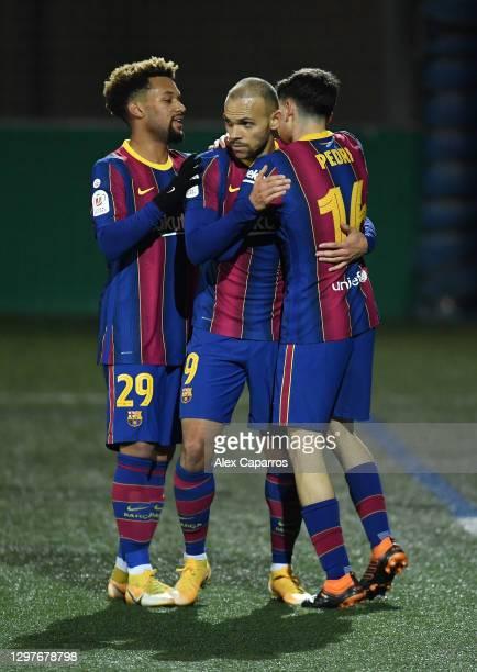 Martin Braithwaite of Barcelona celebrates with team mates Konrad de la Fuente and Pedri after scoring their side's second goal during the Copa del...