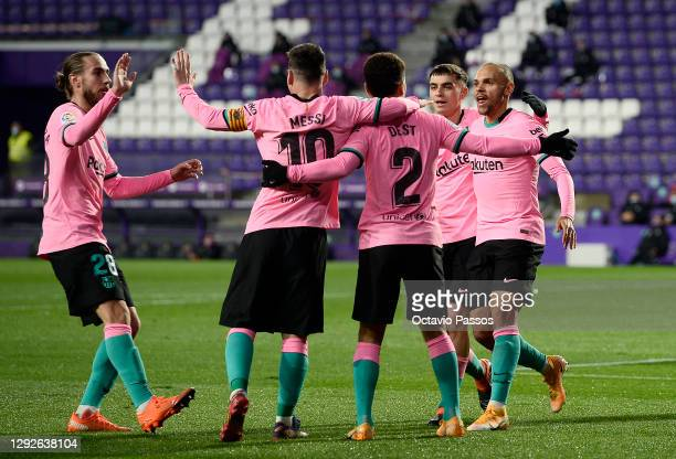 Martin Braithwaite of Barcelona celebrates with teammates after scoring their team's second goal during the La Liga Santander match between Real...