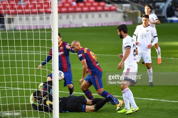 Martin Braithwaite of Barcelona scores their sides first goal past Sergio Herrera of CA Osasuna during the La Liga Santander match between FC...