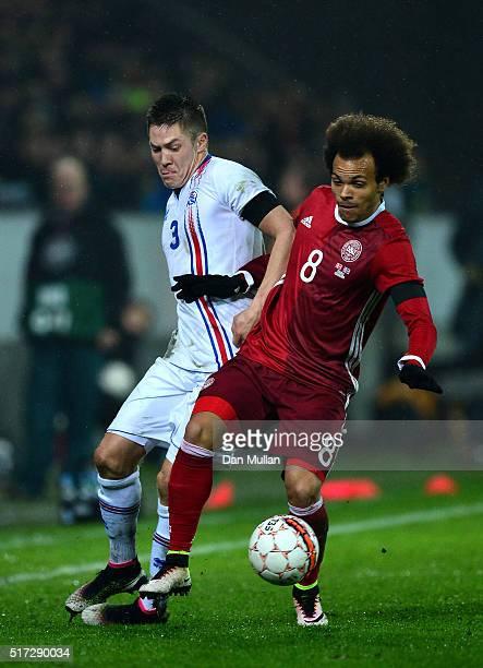 Martin Braithwaite of Denmark holds off Haukur Heidar Hauksson of Iceland during the International Friendly match between Denmark and Iceland at the...