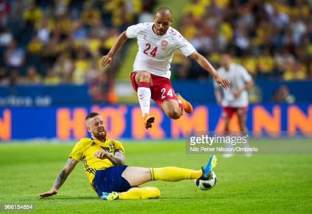 Martin Braithwaite of Denmark is tackled by Pontus Jansson of Sweden during the International Friendly match between Sweden and Denmark at Friends...