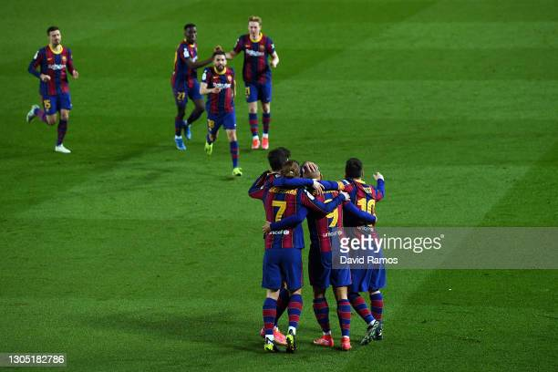 Martin Braithwaite of FC Barcelona celebrates with Antoine Griezmann and Lionel Messi after scoring their side's third goal during the Copa del Rey...