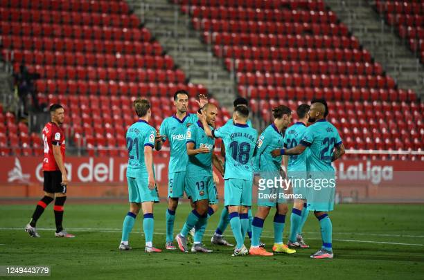 Martin Braithwaite of FC Barcelona celebrates with teammates after scoring his team's second goal during the La Liga match between RCD Mallorca and...