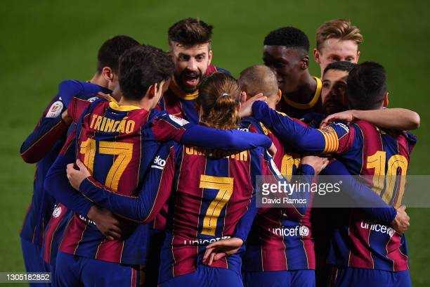 Martin Braithwaite of FC Barcelona celebrates with Trincao, Antoine Griezmann and Lionel Messi after scoring their side's third goal during the Copa...