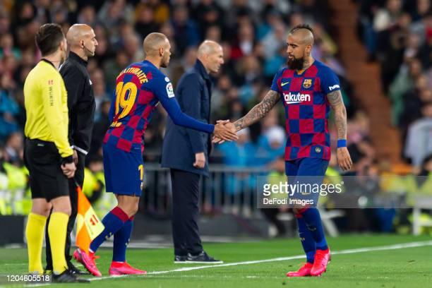 Martin Braithwaite of FC Barcelona substitutes Arturo Vidal of FC Barcelona during the Liga match between Real Madrid CF and FC Barcelona at Estadio...