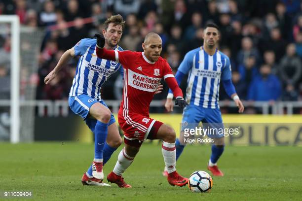 Martin Braithwaite of Middlesbrough is challenged by Dale Stephens of Brighton and Hove Albion during The Emirates FA Cup Fourth Round match between...