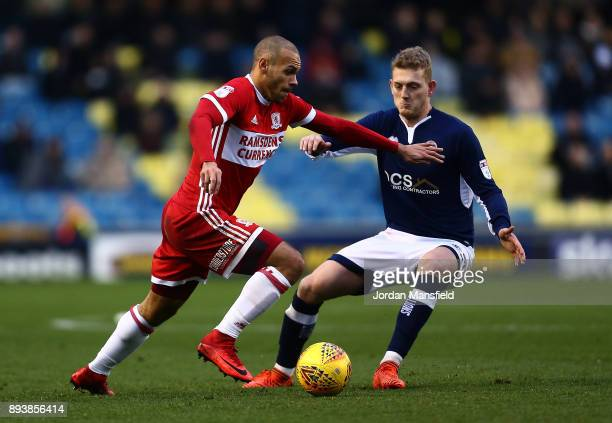 Martin Braithwaite of Middlesbrough takes the ball past George Saville of Millwall during the Sky Bet Championship match between Millwall and...