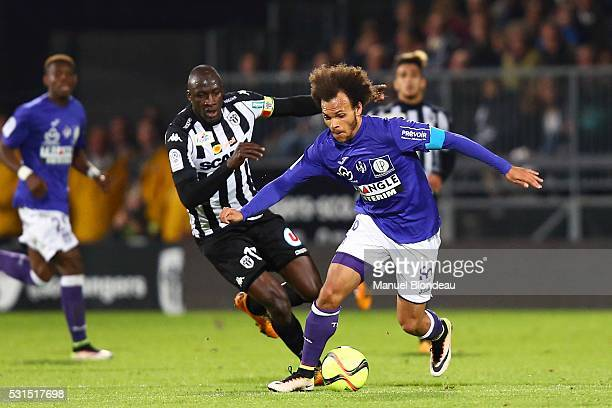 Martin Braithwaite of Toulouse and Cheikh Ndoye of Angers during the football french Ligue 1 match between Angers SCO and Toulouse FC on May 14 2016...