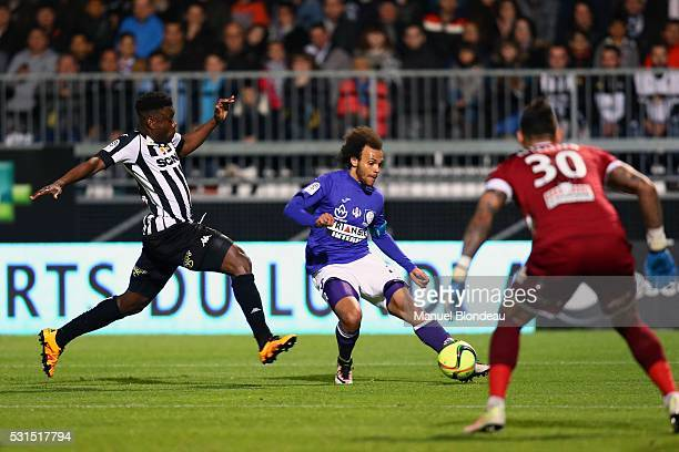 Martin Braithwaite of Toulouse and Ismael Traore of Angers during the football french Ligue 1 match between Angers SCO and Toulouse FC on May 14 2016...